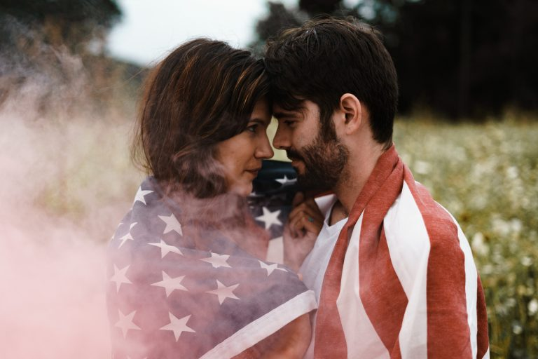 couple wrapped in flag